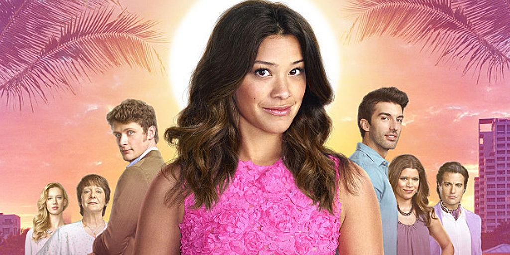 Jane The Virgin -- Image Number: JAV1_Cast.jpg -- Pictured (L-R): Yael Grobglas as Petra, Ivonne Coll as Alba, Brett Dier as Michael, Gina Rodriguez as Jane, Justin Baldoni as Rafael, Andrea Navedo as Xo and Jaime Camil as Rogelio -- © 2015 The CW Network, LLC. All rights reserved.